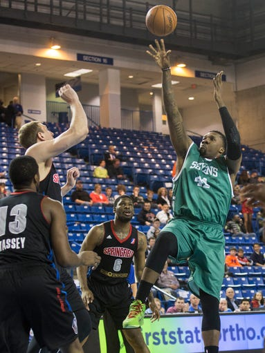 Delaware 87ers center Tiny Gallon puts up a shot in the first quarter of an NBA D-League game between the Delaware 87ers and the Springfield Armor at the Bob Carpenter Center in Newark on Friday night, April 4, 2014. The Sevens fell to the Armor by a score of 125-114.
