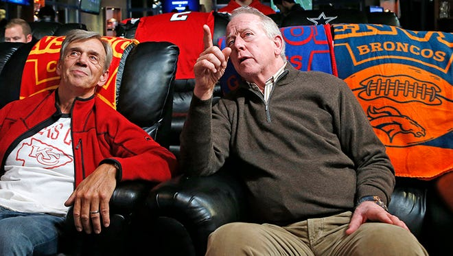Doug Smith, left, father of Kansas City Chiefs quarterback Alex Smith, talks to Archie Manning, father of Denver Broncos quarterback Peyton Manning and New York Giants quarterback Eli Manning, during halftime of an NFL football game in which the Chiefs faced the Broncos, Sunday, Nov. 15, 2015, in New York.