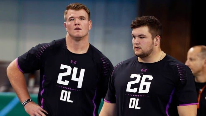 Notre Dame Fighting Irish offensive lineman Mike McGlinchey (24) and Quenton Nelson (26) wait their turns to go through workout drills during the 2018 NFL Combine at Lucas Oil Stadium.