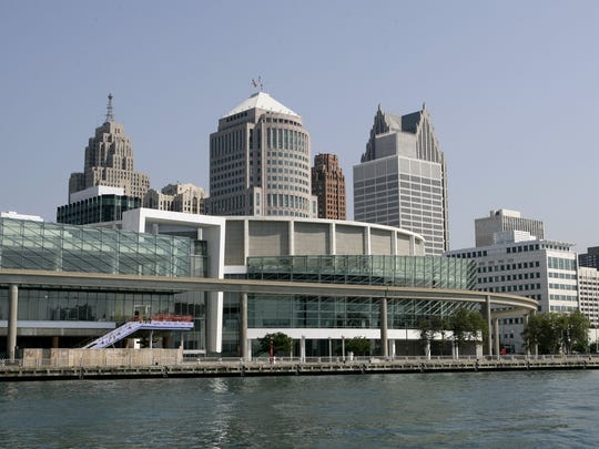 Cobo Center, the foreground building with the glass, is on the Detroit River with the skyline of Detoit in the background. Photographed July 22, 2014.