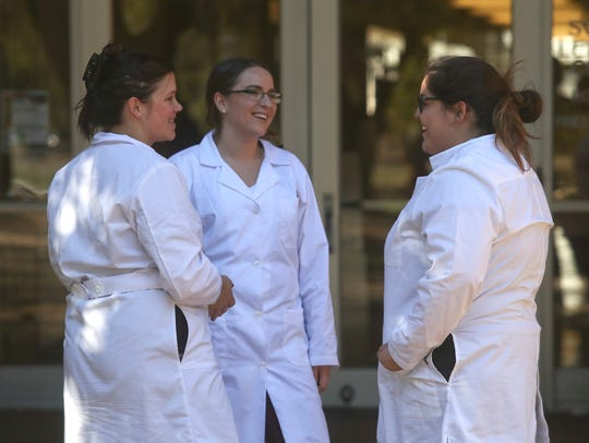 Shasta College students Cortney Norton, from left, Nicole Reiter, and Amanda Ayoub talk during a break from their microbiology class.