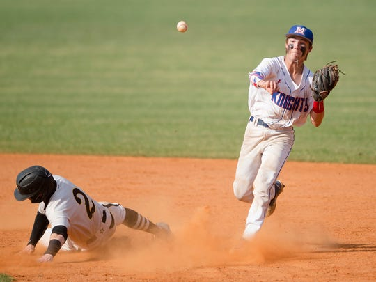 Macon East's J.C. Ceman turns a double play as Autuaga's Tyson Tubbs slides into second during the first game of the AISA Class AA State Baseball Championship between Autauga Academy and Macon East Academy on Tuesday, May 8, 2018, in Montgomery, Ala.