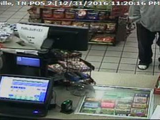 Police are searching for the man in these surveillance images who they say robbed a Circle K Dec. 31, 2016.