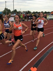 Brighton's Lauren Parrell (18) was 22nd and Pinckney's Isabella Garcia (13) was 24th in the 3,200-meter run at the state Division 1 track and field meet on June 2, 2017.