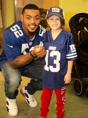 Halle, 7, from Sparta, had the biggest smile on her face Monday when she met one of her favorite New York Giants players, Jonathan Casillas, at PSE&G Children's Specialized Hospital in New Brunswick.