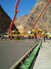 Crews work on a new bridge deck in the Virgin River Gorge Tuesday.