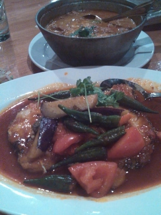 How about a Malaysian dinner after the game? You can in Minneapolis. Sea bass in a tamarind sauce with okra, green beans and eggplant.