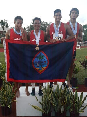 Guam National Track and Field gold medal men's 1,600m relay team, from left: Josh Ilustre (third leg), Paul Dimalanta (first leg), Matt Pangelinan (anchor), Matt Wong (second leg).