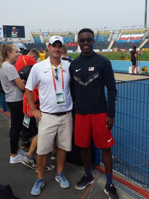 Stanley, pictured here with FSU student Armani Wallace, is a sports psychologist for the U.S. Track and Field team.
