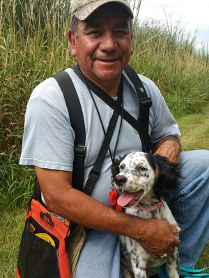 Joe Rodriguez with Madison, a 5 month old English Setter.