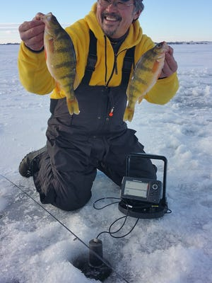 Ted Takasaki on a successful day of ice fishing.