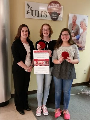 From left: Megan Farmer with Girl Scouts Katelyn Horn and Abigail Paccone.