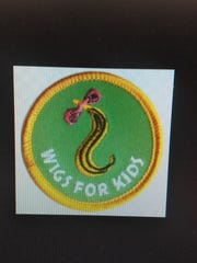 Jaeana Smith's first Girl Scout badge was for Wigs for Kids.