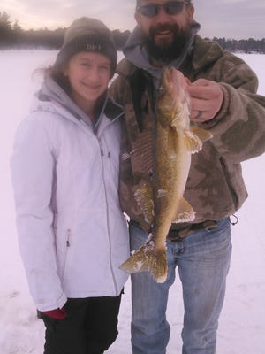Kate and Tony Derleth with Kate's 18 inch walleye.
