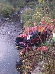 A car, which rolled down an embankment near Muddy