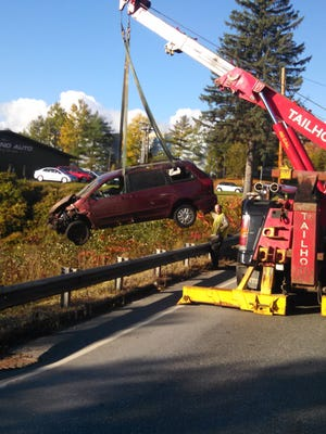 Tailhook Towing lifts the car that crashed Sunday morning after police said its operator fell asleep at the wheel along Williston Road.
