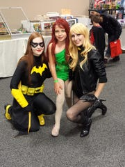 Meg Brooks hangs out with some heroines at the Vermont Comic Con event Saturday.