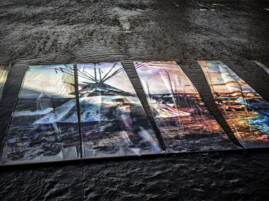 "Ryan Spencer's ""Oil+Water"" won for art installation."