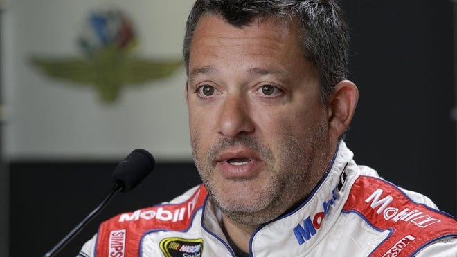Sprint Cup Series driver Tony Stewart (14) talks to the media Friday, July 22, 2016, afternoon at the Indianapolis Motor Speedway.