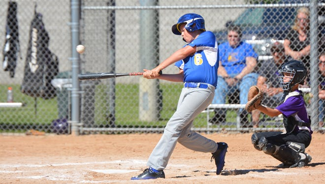 Carter Koch of Oconto connects on an RBI single in the Little League game against Gladstone.