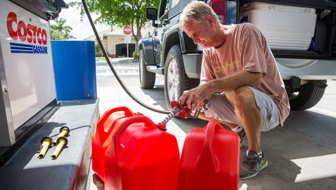 Bill Giebelhouse fills up multiple tanks of gasoline in preparation for Hurricane Irma at the Costco gas station in Naples on Tuesday, Sept. 5, 2017. On Monday, Gov. Rick Scott issued a state of emergency for Florida.