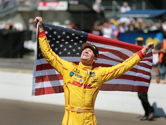 Ryan Hunter-Reay celebrates after he won the 98th running of the Indianapolis 500 at the Indianapolis Motor Speedway, May 25, 2014.
