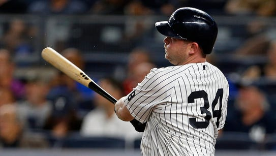 The Yankees' Brian McCann follows through on a solo