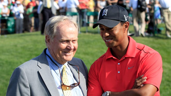 Jack Nicklaus, left, talks with Tiger Woods after Woods won the Memorial golf tournament at the Muirfield Village Golf Club in Dublin, Ohio, Sunday, June 3, 2012.