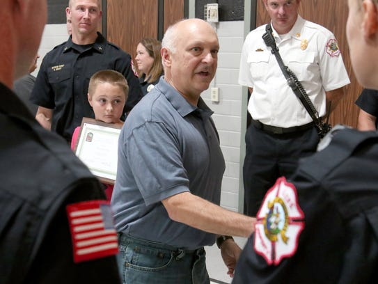 Ryan's father, Mark, meets the paramedics who responded