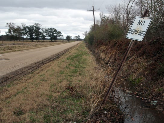 """A """"No Dumping"""" sign is seen Tuesday, January 25, 2011,"""