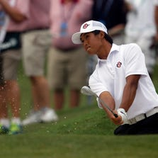 Gunn Yang of Korea hits out of the bunker on the eleventh hole during the final match of the U.S. Amateur Championship