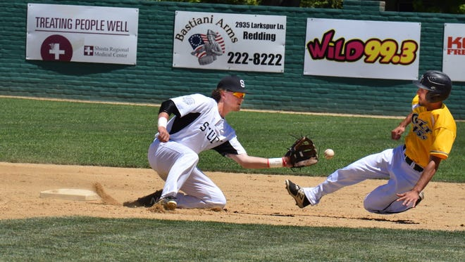 Devin Orr of the Redding Colt 45s slides into second base Sunday as Dylan LaVelle of the Seattle Studs awaits the throw. Orr was safe on a bang-bang play in the second inning. The Studs went on to win 6-5.