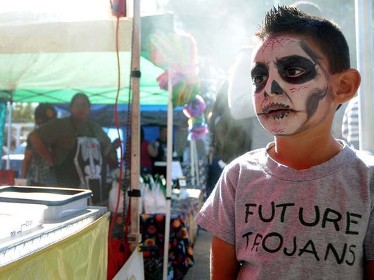 In this file photo, Jordan Trujillo, wears traditional Día de los Muertos face paint during a previous event in Mesilla where his family set up an altar for loved ones who have passed.