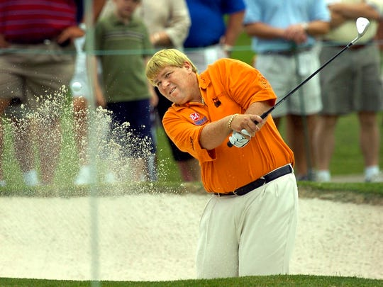 29 May 2005 (jwexgolf1) Photo by Jim Weber: John Daly chips out of the sand on hole 17 during the final round of the FedEx St Jude Classic Sunday at Southwind.