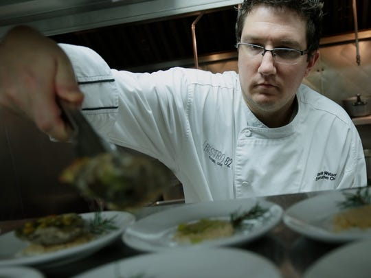 Bistro 82 chef Derik Watson readies the first course of Grilled Chesapeake Bay Oyster during the Detroit Free Press Top 10 Takeover dinner series at the Bistro 82 in Royal Oak, MI, on Monday, August 10, 2015.