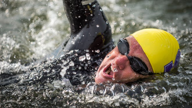 Dr. Andreas Fath, world-record-holding endurance swimmer and professor of Medical and Life Sciences at Furtwangen University in Germany, begins his 652-mile swim of the Tennessee River at Ijams Nature Center on Thursday, July 27, 2017.