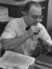 Gerald Kloss pauses with a cigarette, pondering a sentence