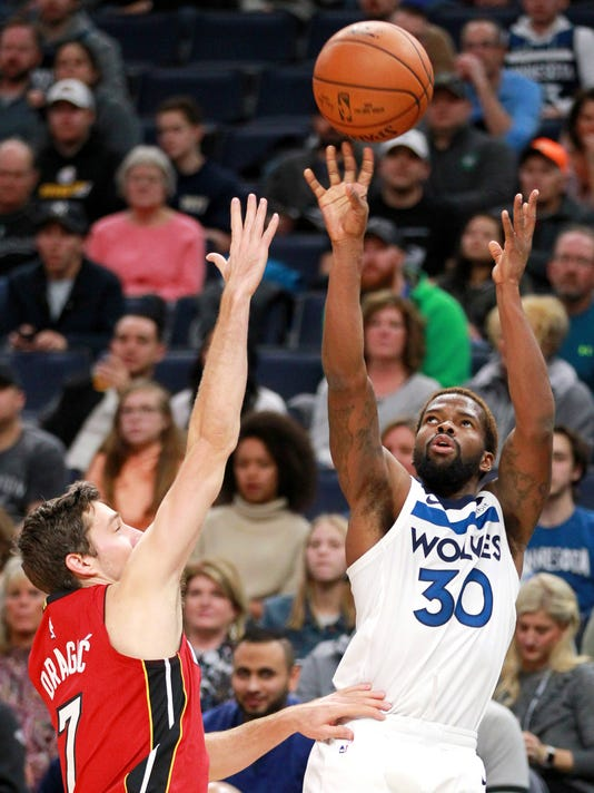 Minnesota Timberwolves guard Aaron Brooks (30) shoots over Miami Heat guard Goran Dragic (7) in the first quarter of an NBA basketball game on Friday, Nov. 24, 2017, in Minneapolis. (AP Photo/Andy Clayton-King)