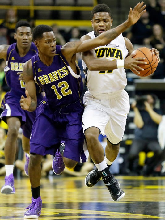Iowa guard Trey Dickerson, right, is fouled by Alcorn State guard Corey Barnes during the second half of an NCAA college basketball game, Tuesday, Dec. 9, 2014, in Iowa City, Iowa. Iowa won 67-44. (AP Photo/Charlie Neibergall)