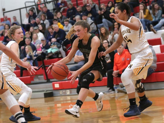 Madison's Leah Boggs grabs a loose ball during the