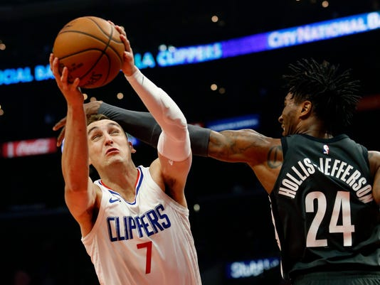 Los Angeles Clippers forward Sam Dekker, left, gets fouled by Brooklyn Nets forward Rondae Hollis-Jefferson during the first half of an NBA basketball game, Sunday, March 4, 2018, in Los Angeles. (AP Photo/Ringo H.W. Chiu)