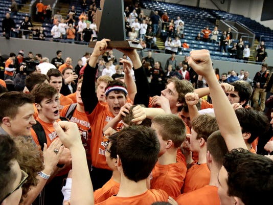 Brightons Nick Brish hoists the State Championship Trophy as his team mates .jpg