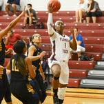 Florida Tech's Shequana Harris (1) drives to the basket during Saturday's game against Embry-Riddle.
