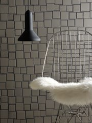 This undated photo provided by Brix shows Designer Aki Motoyama's Cloud design, which softens the grid of some traditional mosaic patterns. Five different porcelain stoneware sizes, available in matte or shiny finish, or mixed, create a flow evocative of a floating cloud. (Oscar Morandi/Brix via AP)