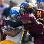 Minnesota Golden Gophers linebacker Damien Wilson (5) tackles San Jose State Spartans running back Jarrod Lawson (21) for a loss in the first quarter at TCF Bank Stadium last season.