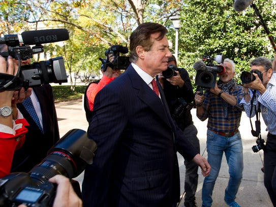 Paul Manafort, accompanied by his lawyers, arrives