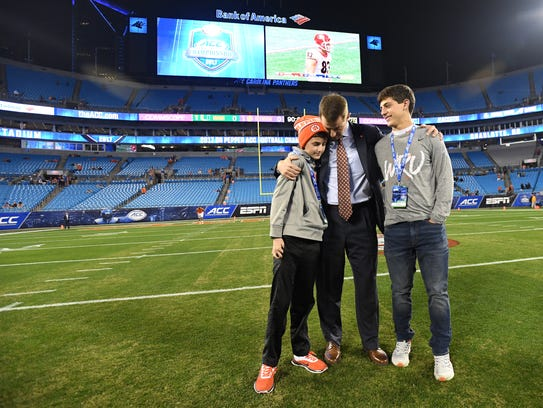 Clemson head coach Dabo Swinney stands with his sons