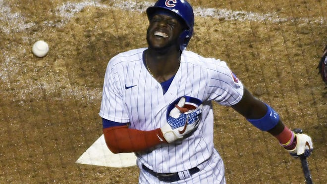 Chicago Cubs' Cameron Maybin reacts after being hit by a pitch with the bases loaded on Tuesday in Chicago.