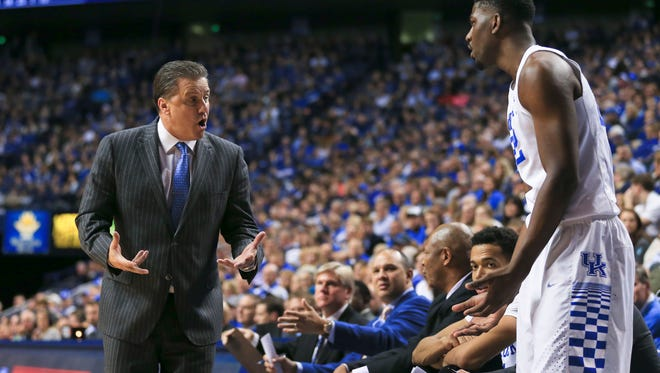 Kentucky's John Calipari makes a rather emphatic point with player Alex Poythress during the game against Ole Miss.