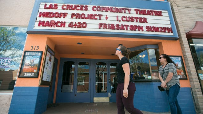 Tiffany Murray, 21, left, and Madison Braun, 23, of Nashville, Tennessee, walk past the Las Cruces Community Theatre on Monday, March 7, 2016, as they tour the city. The owners of the State Theatre building, which houses the theater, have announced their intentions to sell. The LCCT is trying to raise money so the group can stay in the downtown building.